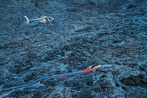 Photographing by helicopter over Kilauea