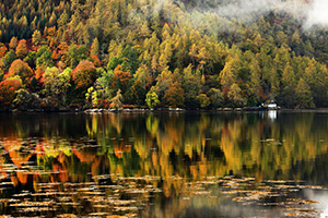 Autumn reflections in Scottish loch