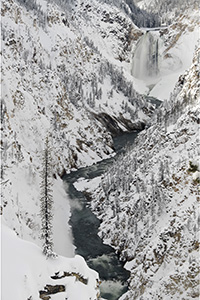 Waterfall and river canyon in winter