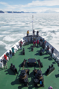 Photographers on the bow of our Antarctica ship