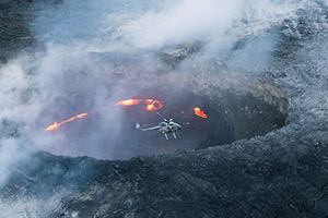 Helicopter over volcano in Hawaii